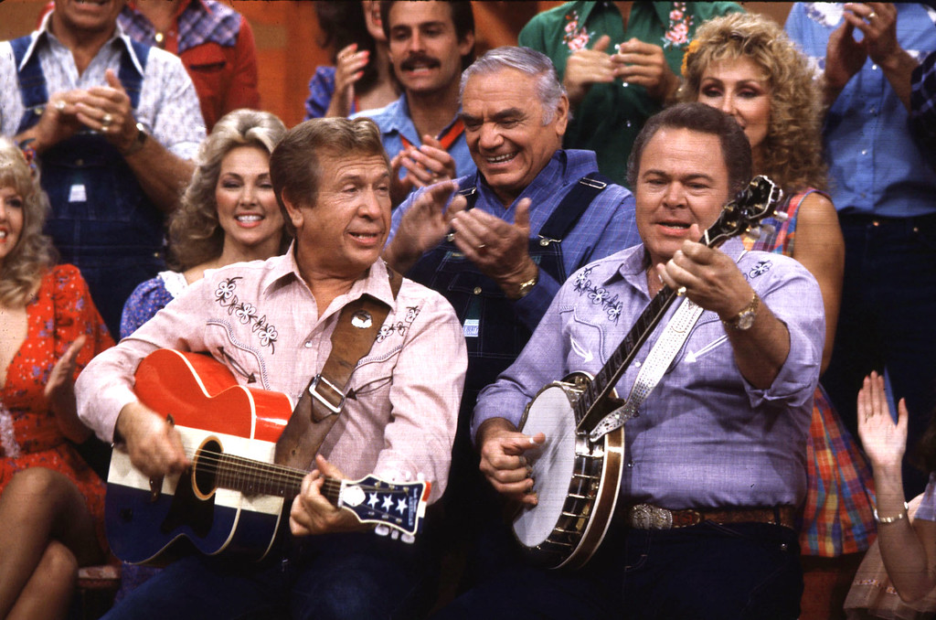 ". Co-hosts Buck Owens, left, and Roy Clark, right, perform with other cast members during a taping of ""Hee Haw\"" in 1986 in Nashville, Tenn.  (AP Photo/Mark Humphrey)"