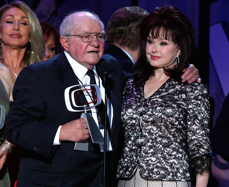 ". SANTA MONICA, CA - APRIL 14:  Producer Sam Lovullo and Naomi Judd accept the Entertainers Award for ""Hee Haw\"" onstage during the 5th Annual TV Land Awards held at Barker Hangar on April 14, 2007 in Santa Monica, California.  Publicists the Brokaw Company said Thursday, Jan. 5, 2017, that Lovullo died at his home in Los Angeles on Tuesday, Jan 3, 2017. He had been suffering from heart disease. He was 88. (Photo by Kevin Winter/Getty Images)"