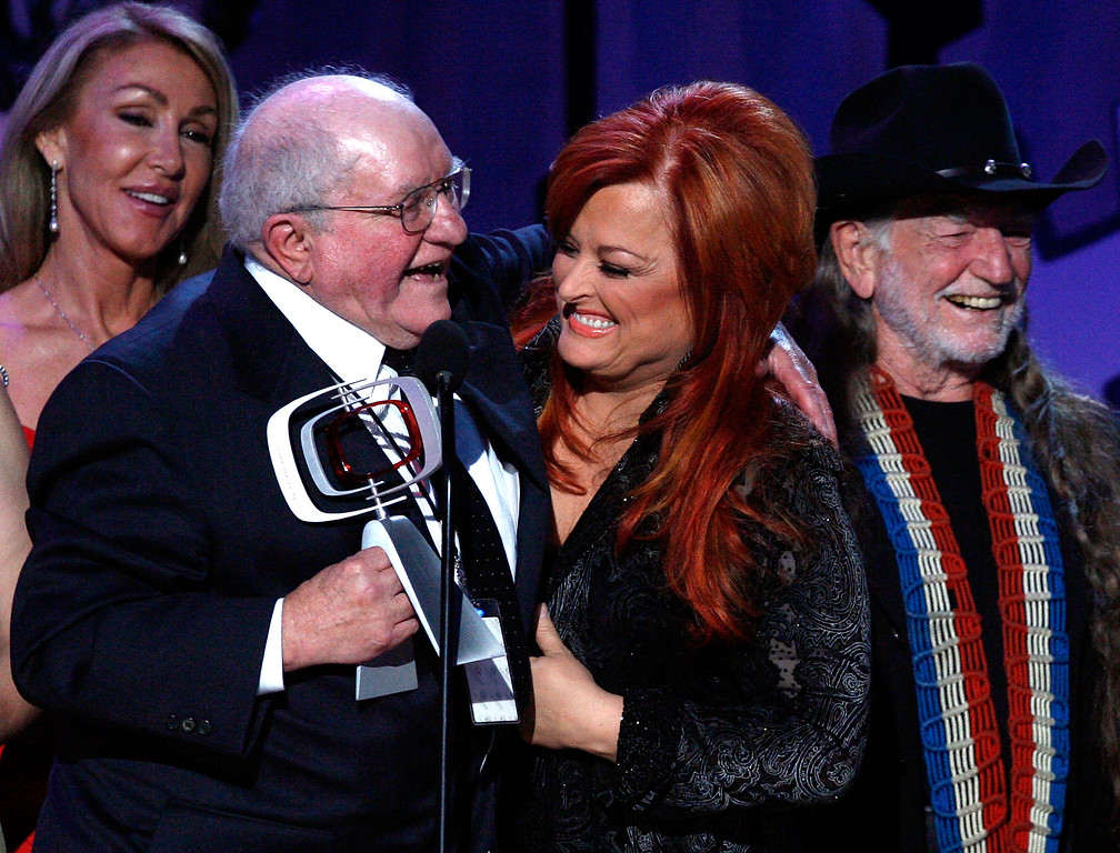 . SANTA MONICA, CA - APRIL 14:  Producer Sam Lovullo, Wynonna Judd and musician Willie Nelson accept the Entertainers Award onstage during the 5th Annual TV Land Awards held at Barker Hangar on April 14, 2007 in Santa Monica, California.  Publicists the Brokaw Company said Thursday, Jan. 5, 2017, that Lovullo died at his home in Los Angeles on Tuesday, Jan 3, 2017. He had been suffering from heart disease. He was 88.  (Photo by Kevin Winter/Getty Images)
