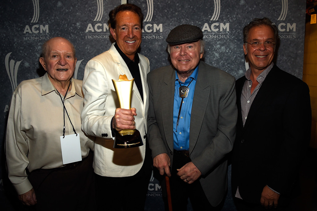 . Hee-Haw producer Sam Lovullo, Mae Boren Axton Award recipient Barry Adelman, Roy Clark and RAC Clark pose backstage during the 9th Annual ACM Honors at the Ryman Auditorium on September 1, 2015 in Nashville, Tennessee. Publicists the Brokaw Company said Thursday, Jan. 5, 2017, that Lovullo died at his home in Los Angeles on Tuesday, Jan 3, 2017. He had been suffering from heart disease. He was 88. (Photo by Rick Diamond/Getty Images for ACM)