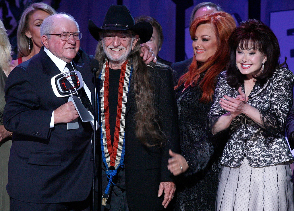 . SANTA MONICA, CA - APRIL 14:  Producer Sam Lovullo, musician Willie Nelson, Wynonna Judd and Naomi Judd accept the Entertainers Award onstage during the 5th Annual TV Land Awards held at Barker Hangar on April 14, 2007 in Santa Monica, California.    (Photo by Kevin Winter/Getty Images)