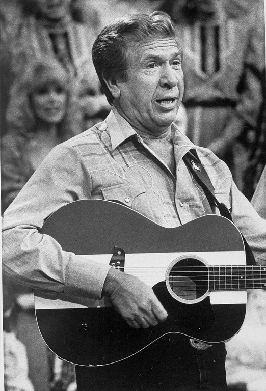 ". Buck Owens, the grinning co-host of the 16-year-old television show ""Hee Haw,\"" describes the program as \""an honest show\"" with a bit of honesty himself, June 24, 1985. \""We aren\'t slick,\"" Owens says of the country music comedy. \""We don\'t even rehearse.\""  (AP Photo/Mark Humphrey)"