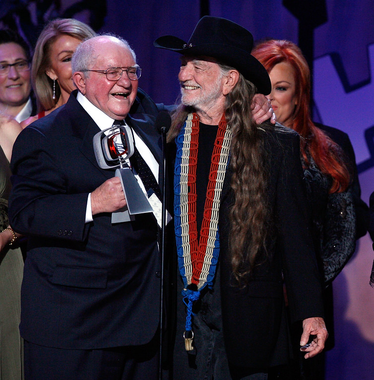 . SANTA MONICA, CA - APRIL 14:  Producer Sam Lovullo and musician Willie Nelson accept the Entertainers Award onstage during the 5th Annual TV Land Awards held at Barker Hangar on April 14, 2007 in Santa Monica, California.  Publicists the Brokaw Company said Thursday, Jan. 5, 2017, that Lovullo died at his home in Los Angeles on Tuesday, Jan 3, 2017. He had been suffering from heart disease. He was 88. (Photo by Kevin Winter/Getty Images)