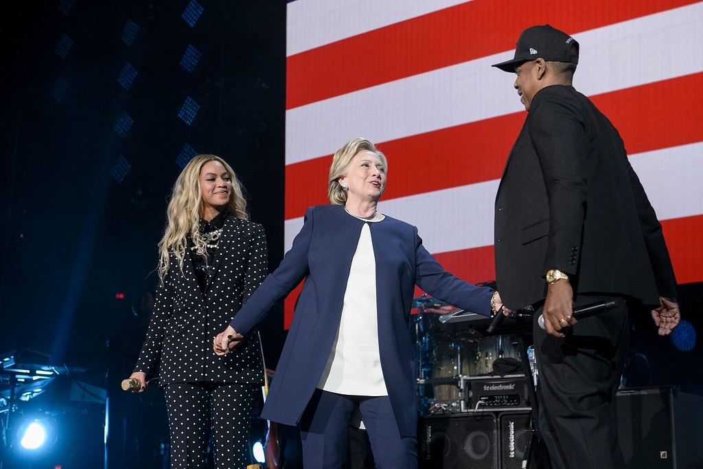. Democratic presidential nominee Hillary Clinton (C) stands with Beyonce (L) and Jay Z  during a Get Out the Vote (GOTV) performance in support of Democratic presidential nominee Hillary Clinton at the Wolstein Center November 4, 2016 in Cleveland, Ohio. / AFP / Brendan Smialowski        (Photo credit should read BRENDAN SMIALOWSKI/AFP/Getty Images)