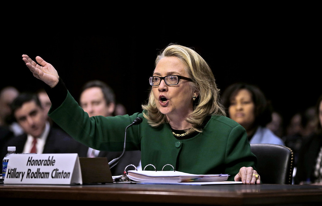 . Secretary of State Hillary Rodham Clinton testifies on Capitol Hill in Washington, Wednesday, Jan. 23, 2013, before the Senate Foreign Relations Committee hearing on the deadly September attack on the U.S. diplomatic mission in Benghazi, Libya, that killed Ambassador Chris Stevens and three other Americans.  (AP Photo/Pablo Martinez Monsivais)