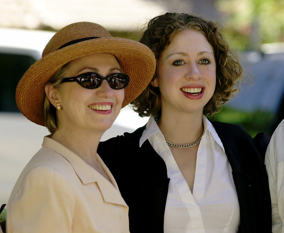 . Chelsea Clinton, right, wears a graduation gown as she smiles with her mother, Sen. Hillary Rodham Clinton, D-N.Y., after attending a religious service with other Stanford graduates on the Stanford University campus in Stanford, Calif., Saturday, June 16, 2001.  (AP Photo/Paul Sakuma)