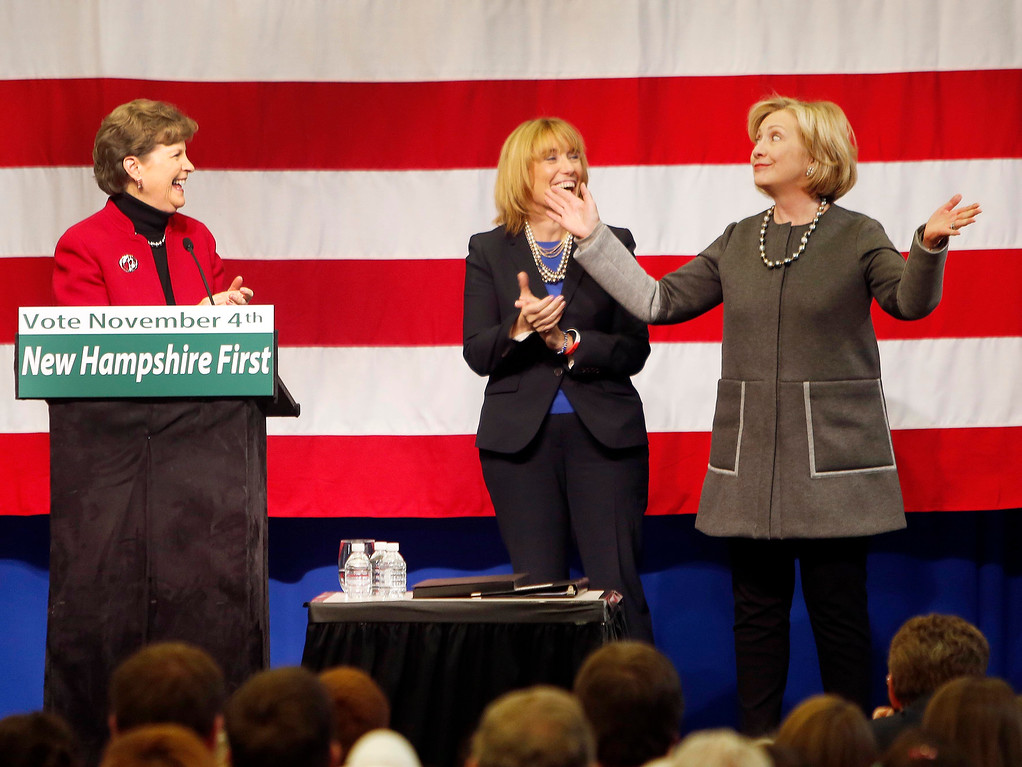 . Hillary Rodham Clinton, right, reacts as she is introduced by U.S. Sen. Jeanne Shaheen, D-N.H., far left, and Gov. Maggie Hassan, D-N.H., during a get out the vote rally center, Sunday, Nov. 2, 2014 in Nashua, N.H. (AP Photo/Jim Cole)