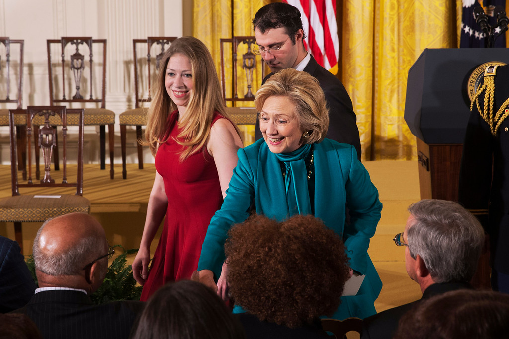 . Former Secretary of State Hillary Rodham Clinton, her daughter Chelsea Clinton, and Chelsea\'s husband Marc Mezvinsky, arrive in the East Room of the White House in Washington, Wednesday, Nov. 20, 2013, for a ceremony where President Barack Obama awarded former President Bill Clinton, and others, with the Presidential Medal of Freedom. (AP Photo/Jacquelyn Martin)