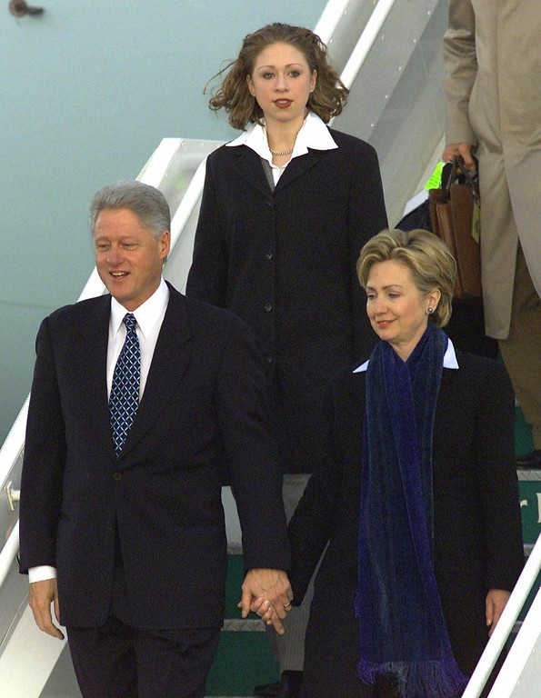 . President Clinton and first lady Hillary Rodham Clinton hold hands as they step down from  Air Force One with their daughter Chelsea at Dublin airport, Ireland Tuesday, December 12, 2000, to begin a three day visit to Ireland, Northern Ireland and England. (AP Photo/Martin Cleaver)