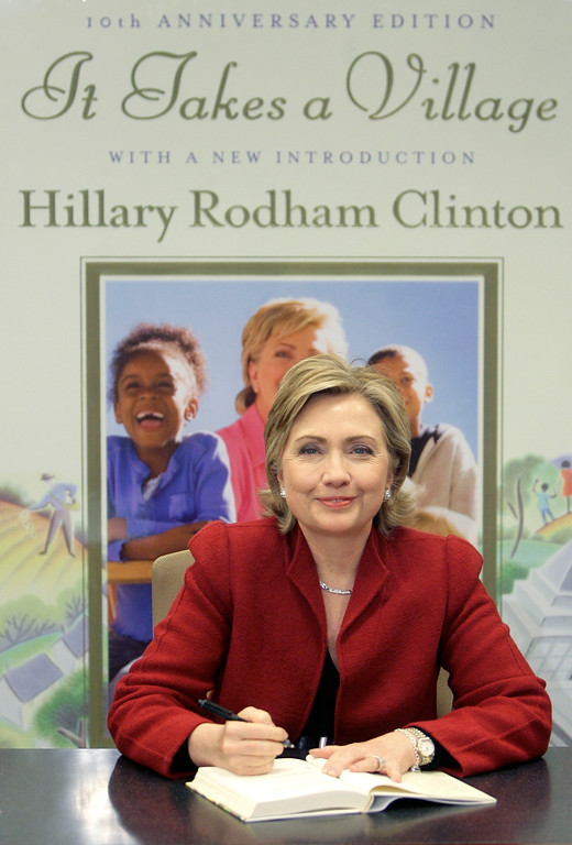 ". Senator Hillary Rodham Clinton signs copies of the her book ""It Takes a Village\"" in New York, Monday, Dec. 18, 2006.   (AP Photo/Seth Wenig)"