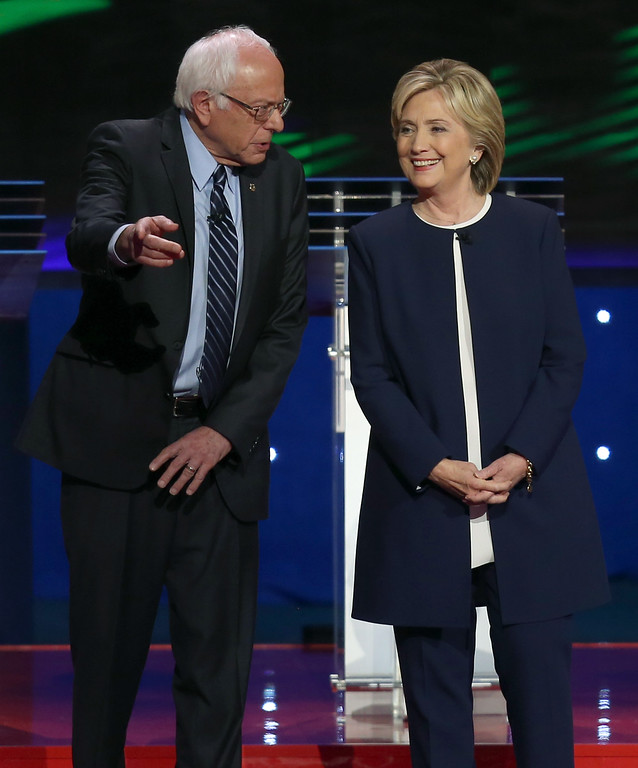 . LAS VEGAS, NV - OCTOBER 13:  Democratic presidential candidates Sen. Bernie Sanders (I-VT) (L) and Hillary Clinton take the stage before a presidential debate sponsored by CNN and Facebook at Wynn Las Vegas on October 13, 2015 in Las Vegas, Nevada. Five Democratic presidential candidates are participating in the party\'s first presidential debate.  (Photo by Joe Raedle/Getty Images)