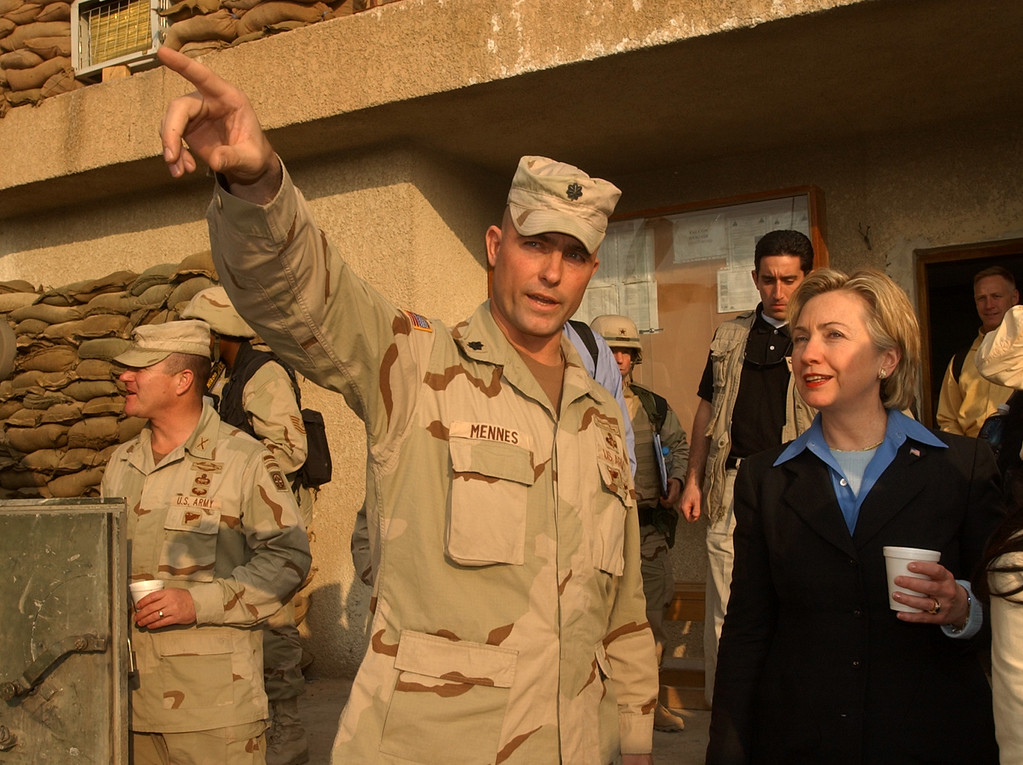 . Sen. Hillary Rodham Clinton gets a tour through barracks of the 2nd battalion 2nd Airborne Division in Baghdad by Lt. Col. Brian Mennes, Friday Nov 28, 2003. (AP Photo/Dusan Vranic/Pool)