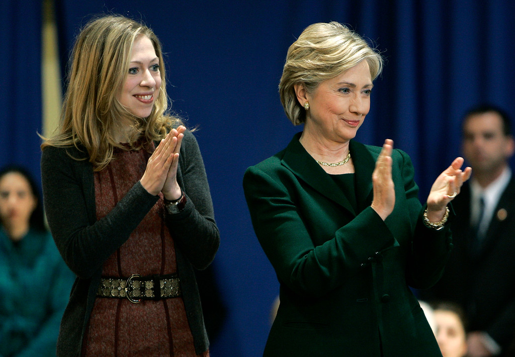 . Democratic presidential hopeful, Sen. Hillary Rodham Clinton, D-N.Y., right and daughter Chelsea greet an audience in Vinton, Iowa Sunday, Dec. 30, 2007. (AP Photo/Paul Sancya)