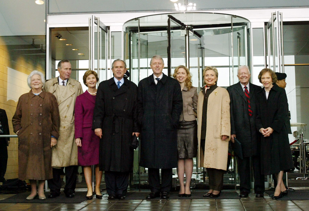 . Former First Lady Barbara Bush, left to right, former President George Bush, First Lady Laura Bush, President George Bush, former President Bill Clinton, Chelsea Clinton, Sen. Hillary Rodham Clinton, former President Jimmy Carter, and former First Lady Rosalynn Carter pose for a photo as they leave the stage at the William J. Clinton Presidential Center, Thursday, Nov. 18, 2004, in Little Rock, Ark.  (AP Photo/Pablo Martinez Monsivais)