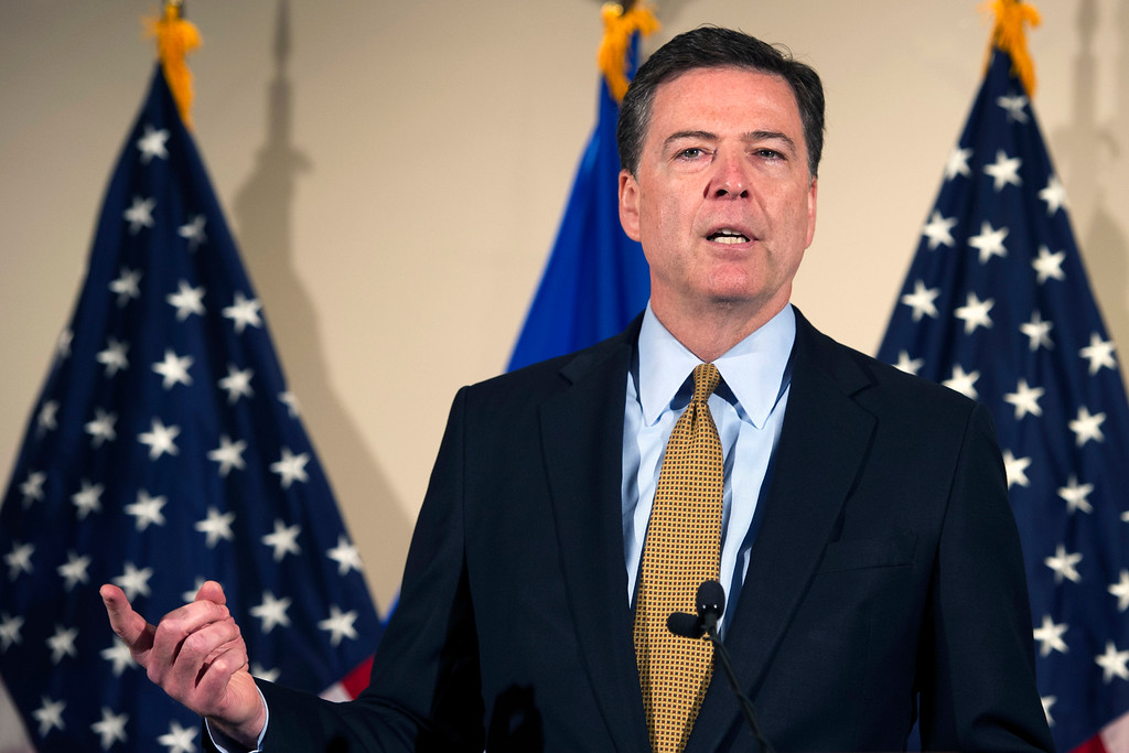 . FBI Director James Comey makes a statement at FBI Headquarters in Washington, Tuesday, July 5, 2016. Comey said 110 emails sent or received on Hillary Clinton\'s server contained classified information.  Comey said the FBI will not recommend criminal charges in its investigation into Hillary Clinton\'s use of a private email server while secretary of state. (AP Photo/Cliff Owen)