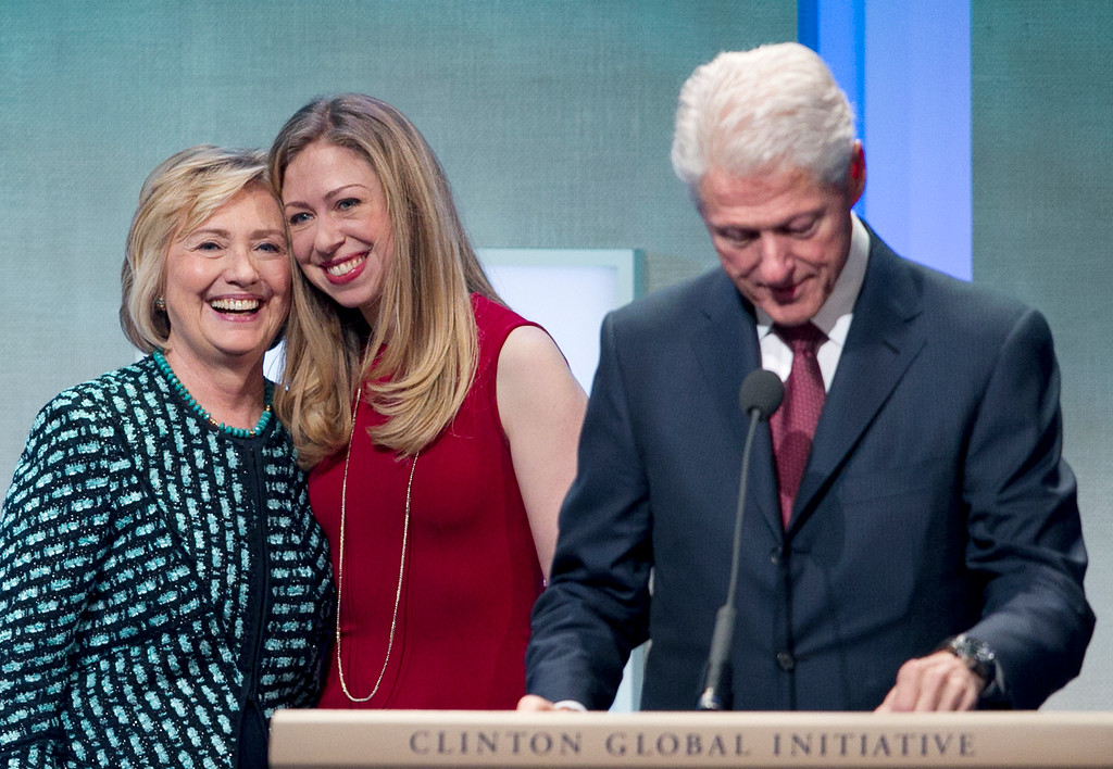 . Former President Bill Clinton prepares to make remarks at the Clinton Global Initiative while his wife, Hillary Rodham Clinton, and daughter, Chelsea, take the stage with him, Tuesday, Sept. 24, 2013 in New York.  (AP Photo/Mark Lennihan)