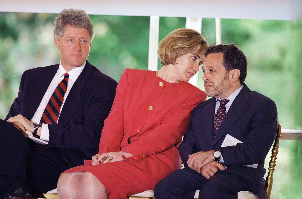 . President Bill Clinton watches a ceremony to honor the signing of the Goals 2000 Educate America Act bill as first lady Hillary Rodham Clinton talks to Labor Secretary Robert Reich at the White House in Washington, May 16, 1994. The president actually signed the bill on March 31, while on vacation, but wanted to have a Washington celebration for the bill which this year authorizes $647 million for education reform. (AP Photo/Joe Marquette)