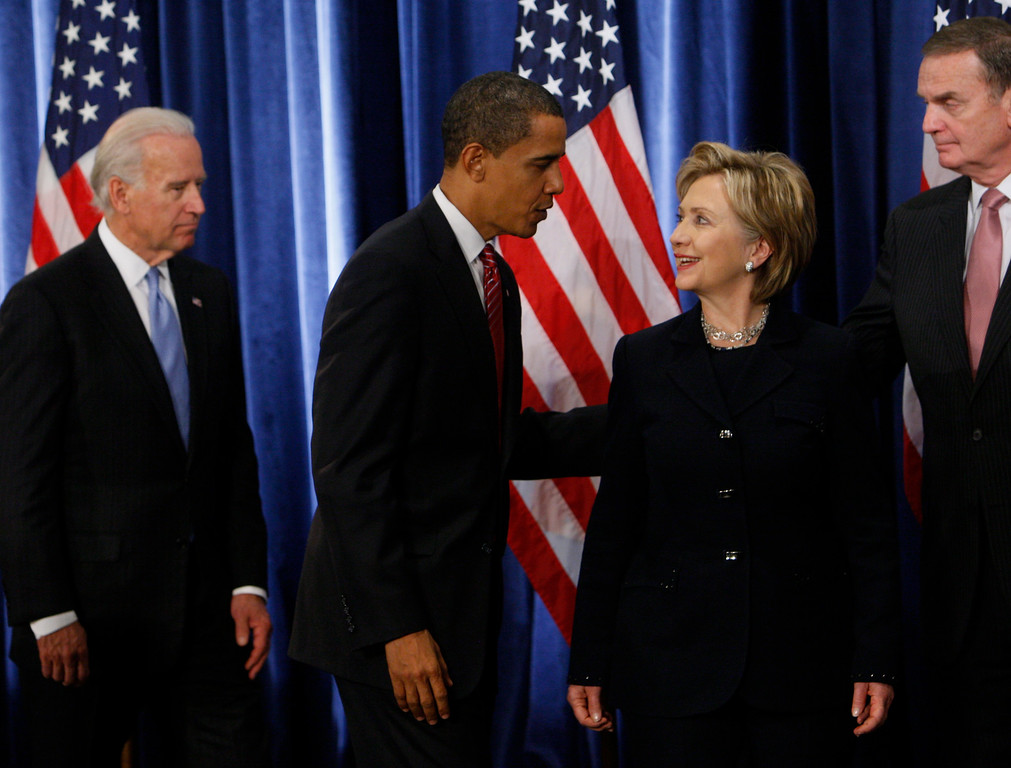 . President-elect Barack Obama, second from left, stands with Secretary of State-designate Sen. Hillary Rodham Clinton, D-N.Y. third from left, as National Security Adviser-designate Ret. Marine Gen. James Jones, far right, and Vice President-elect Joe Biden, far left, leave the stage at the end of a news conference in Chicago, Monday, Dec. 1, 2008. (AP Photo/Charles Dharapak)