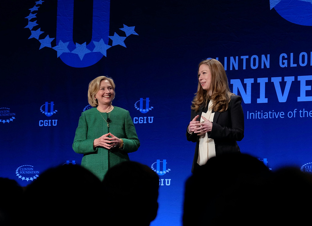 . Former Secretary of State Hillary Rodham Clinton, left, and Chelsea Clinton speak at a university conference sponsored by their Clinton Global Initiative at the University of Miami, Saturday, March 7, 2015, in Coral Gables, Fla.  (AP Photo/Gaston De Cardenas)