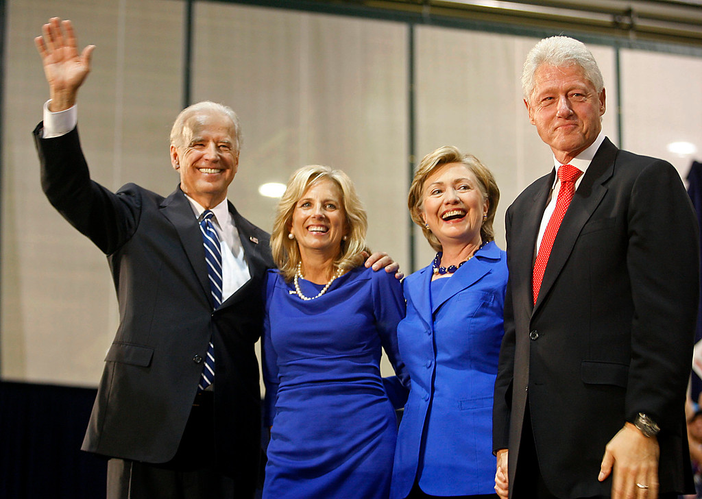 . Democratic vice presidential candidate, Sen. Joe Biden, D-Del., left, his wife Jill Biden, Sen. Hillary Rodham Clinton, D-N.Y. and her husband, former President Bill Clinton, right,  wave to the crowd during a campaign rally in Scranton, Pa. Sunday, Oct. 12, 2008. (AP Photo/Jimmy May)