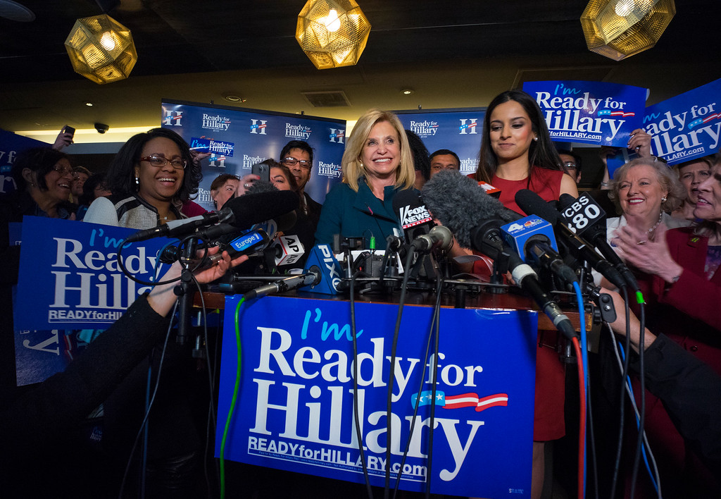 . Rep. Carolyn Maloney, D-N.Y., center, speaks as Jenifer Rajkumar, at right looks on, during part of the Ready for Hillary campaign, Saturday, April 11, 2015, in New York. Dozens of supporters, elected officials and Democratic leaders gathered at the fundraiser the day before Hillary Clinton is expected to officially announce her presidential campaign. Rajkumar is an official with the Ready for Hillary campaign in New York. (AP Photo/Craig Ruttle)