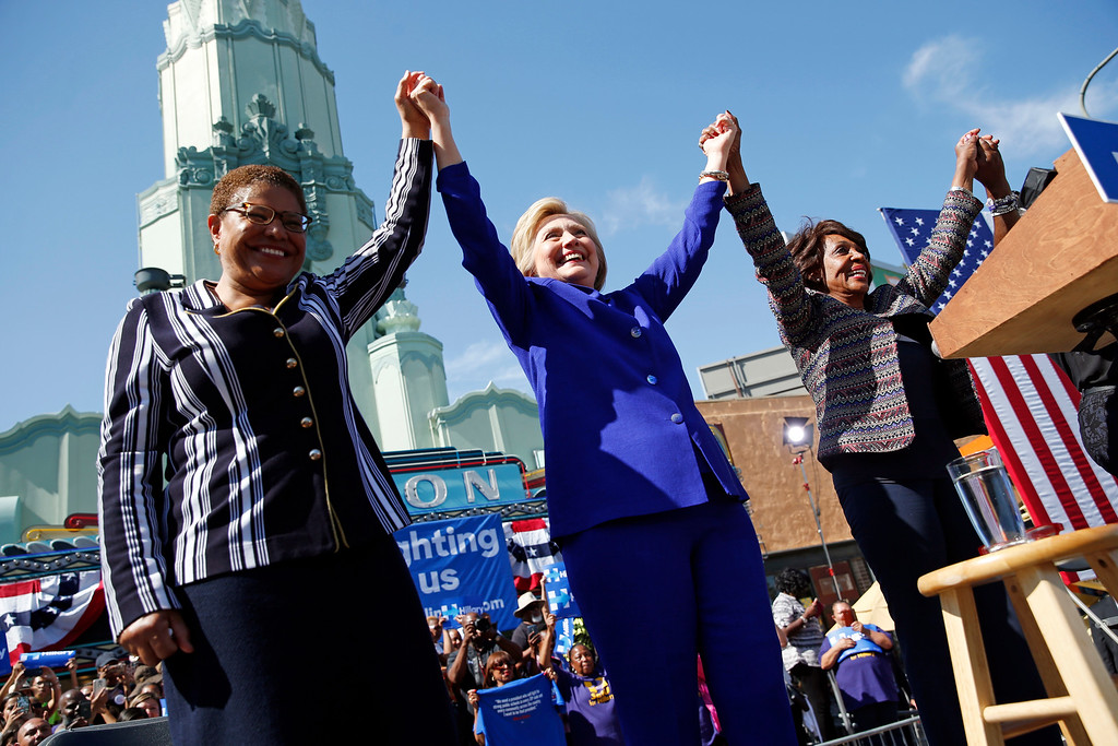 . Democratic presidential candidate Hillary Clinton, center, celebrates at a rally with Rep. Karen Bass, D-Calif., left, and Rep. Maxine Waters, D-Calif., Monday, June 6, 2016, in Los Angeles. (AP Photo/John Locher)