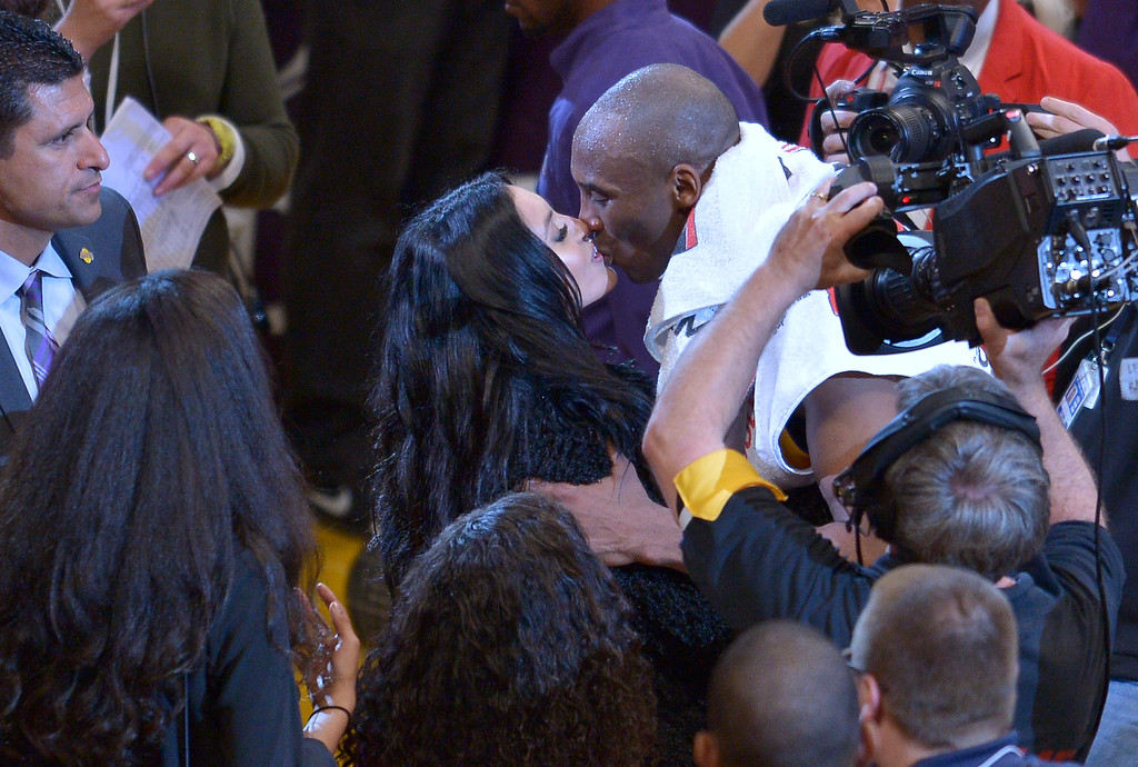 . Kobe Bryant gets a kiss from his wife Vanessa after the game. Bryant scored 60 points in his final game as a Los Angeles Laker, as the Lakers defeated the Utah Jazz 101-96. April 13, 2016. Los Angeles, CA.  (Photo by John McCoy/Southern California News Group)
