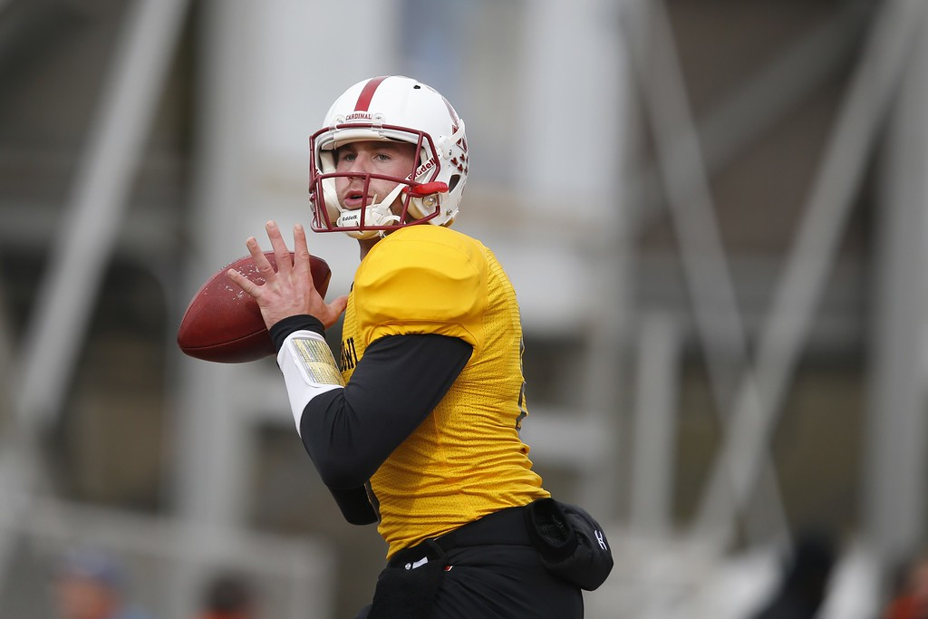 . North Dakota State quarterback Carson Wentz (11), runs through drills during NCAA college football practice for the Senior Bowl, Thursday, Jan. 28, 2016, at Ladd�Peebles Stadium, in Mobile, Ala. The LA Rams are reportedly eyeing Wentz as a possible No. 1 pick in the NFL Draft. (AP Photo/Brynn Anderson)