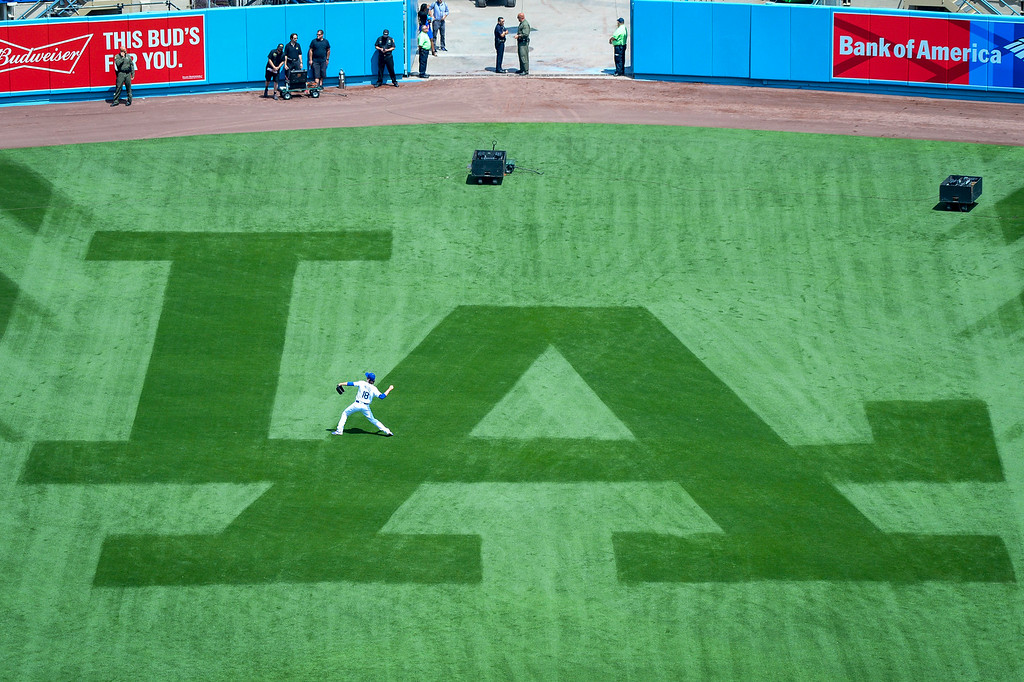 . Dodgers Kenta Maeda warms up in the outfield before the home opener at Dodger stadium Tuesday, April 12, 2016.     (Photo by David Crane Southern California News Group)
