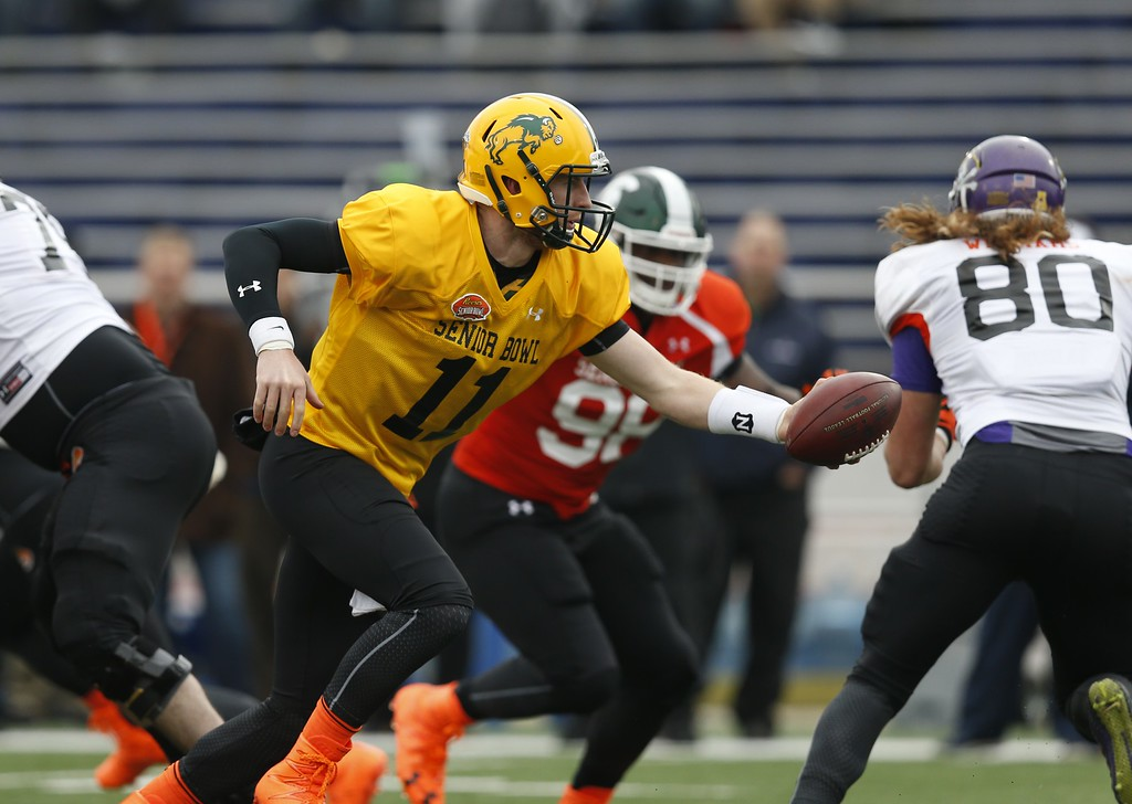 . North Dakota State quarterback Carson Wentz (11), runs through drills during NCAA college football practice for the Senior Bowl, Wednesday, Jan. 27, 2016, at Ladd�Peebles Stadium, in Mobil, Ala. The LA Rams are reportedly eyeing Wentz as a possible No. 1 pick in the NFL Draft. (AP Photo/Brynn Anderson)