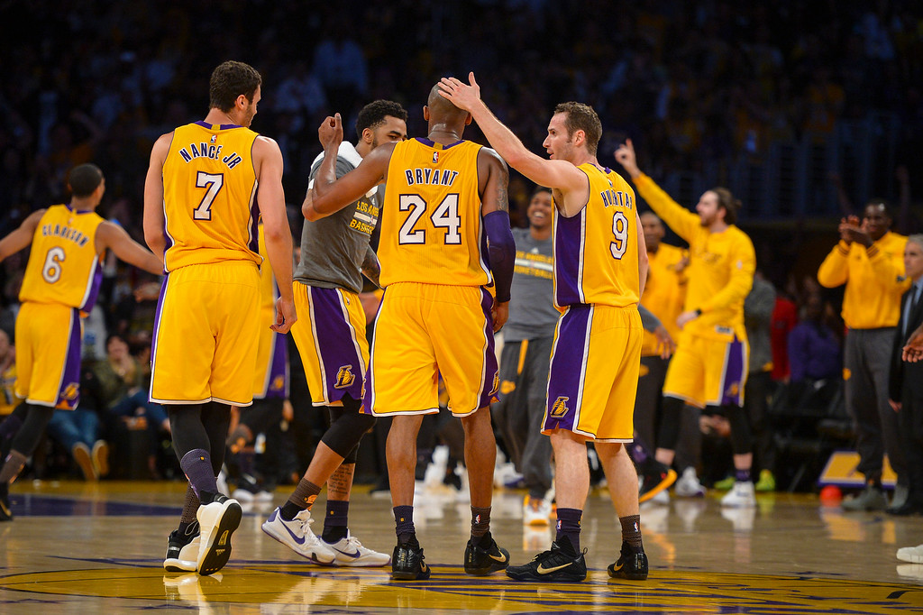 . Kobe Bryant is greeted by teammates on his way to scoring 60 points in the final game of his career against the against the Utah Jazz. April 13, 2016. Los Angeles, CA.  The Lakers defeated the Jazz 101-96.  (Photo by David Crane/Southern California News Group)