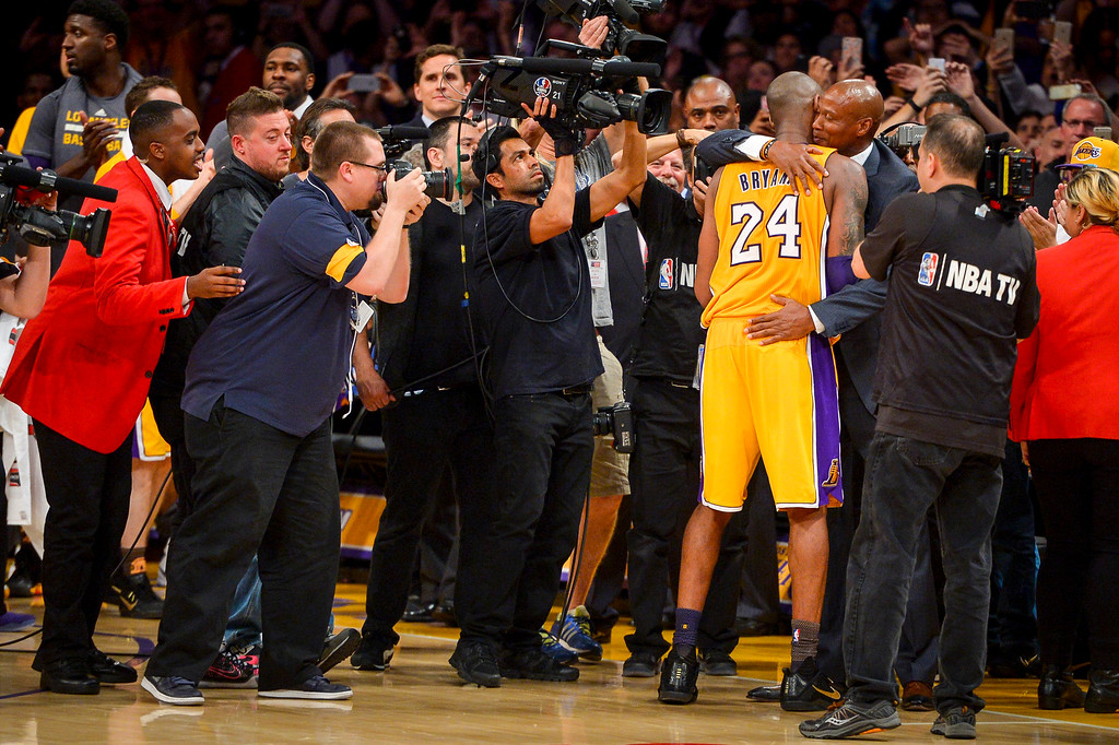 . Kobe Bryant is embraced by coach Bryan Scott after  scoring 60 points in the final game of his career against the against the Utah Jazz. April 13, 2016. Los Angeles, CA.  The Lakers defeated the Jazz 101-96.  (Photo by David Crane/Southern California News Group)