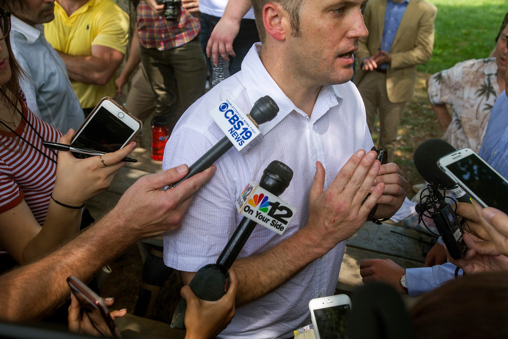 . White nationalist Richard Spencer gives remarks after a white nationalist rally was declared an unlawful assembly on Saturday Aug. 12, 2017,  in Charlottesville, Va. The group had gathered to protest plans by the city of Charlottesville to remove a statue of Confederate Gen. Robert E. Lee. (Shaban Athuman /Richmond Times-Dispatch via AP)