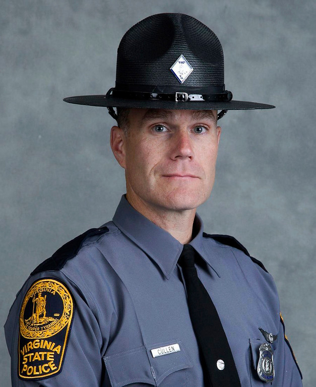 . This undated photo provided by the Virginia State Police shows Lieutenant H. Jay Cullen, of Midlothian, Va. Cullen along with Trooper-Pilot Berke M.M. Bates were killed Saturday, Aug. 12, 2017, when the helicopter they were piloting crashed while assisting public safety resources during clashes at a nationalist rally in Charlottesville, Va.  (Virginia State Police via AP)
