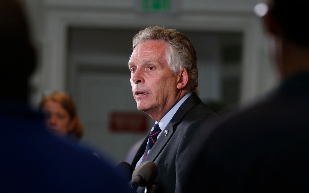 . Virginia Gov. Terry McAuliffe addresses a news conference concerning the white nationalist rally and violence in Charlottesville, Va., Saturday, Aug. 12, 2017. (AP Photo/Steve Helber)
