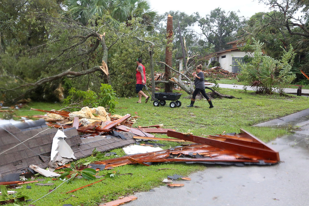 . Debris from a second story roof is scattered over a two-block area after a possible tornado touched down at Palm Bay Point subdivision Sunday, Sept. 10, 2017,as hurricane Irma made landfall in the state of Florida. (Red Huber/Orlando Sentinel via AP)