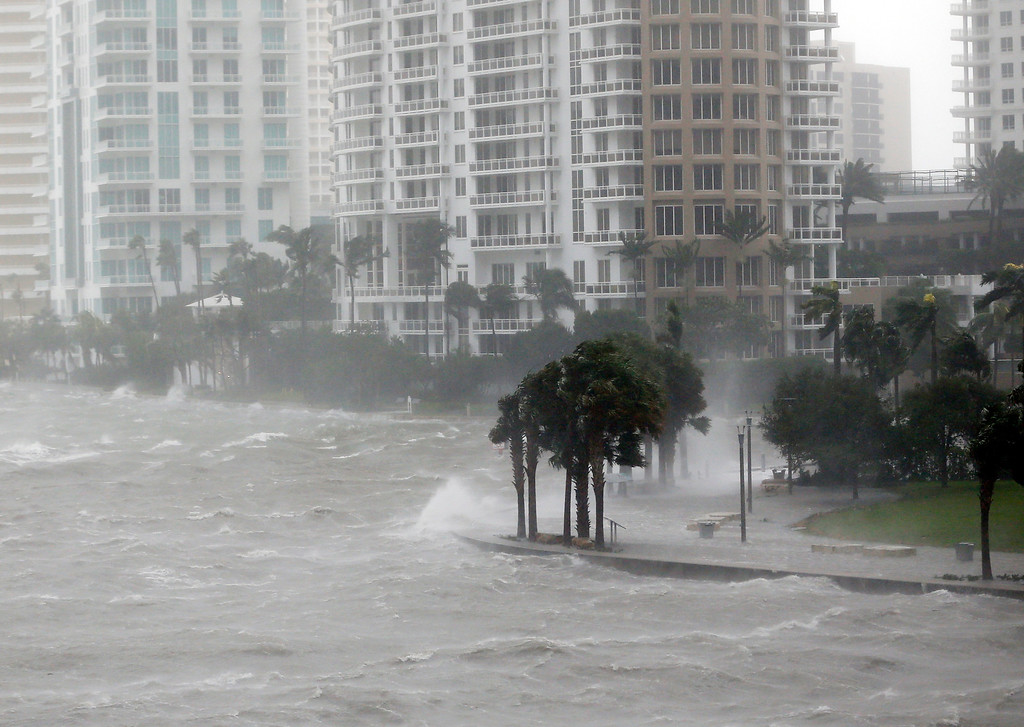 . Waves crash over a seawall at the mouth of the Miami River from Biscayne Bay, Fla., as Hurricane Irma passes by, Sunday, Sept. 10, 2017, in Miami.  (AP Photo/Wilfredo Lee)