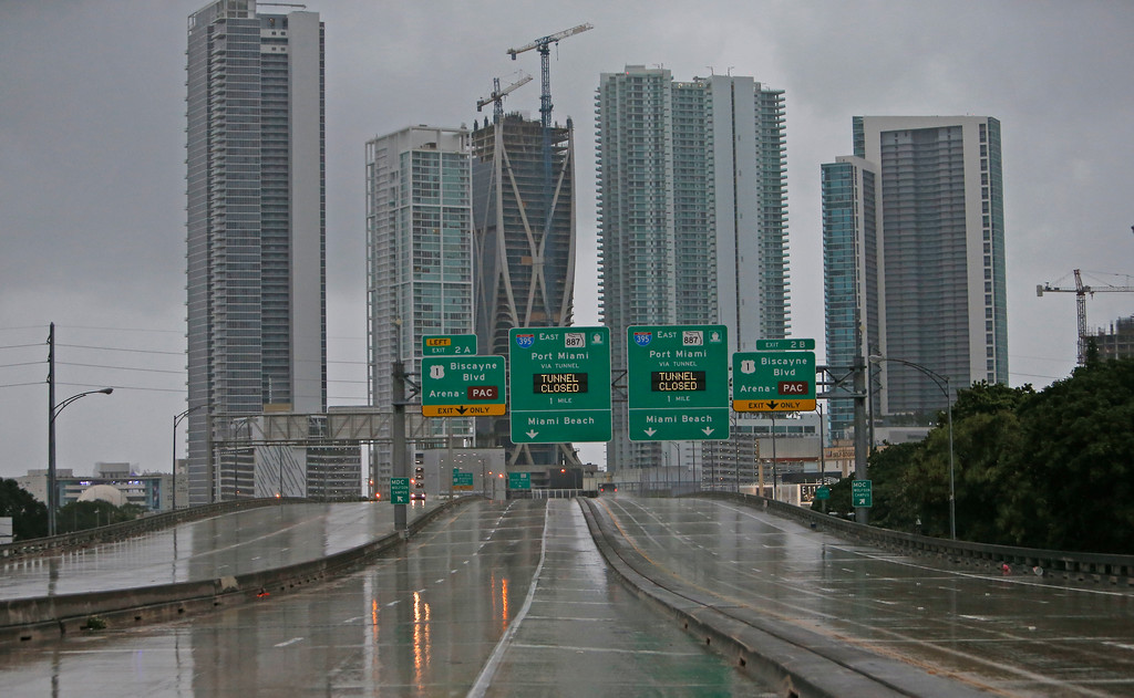 . The Interstate remains empty as the outer bands of Hurricane Irma reached South Florida early Saturday, Sept.  9, 2017 in Miami. Gov. Rick Scott is urging anyone living in an evacuation zone in southwest Florida to leave by noon as the threat of Hurricane Irma has shifted west.  (David Santiago/Miami Herald via AP)