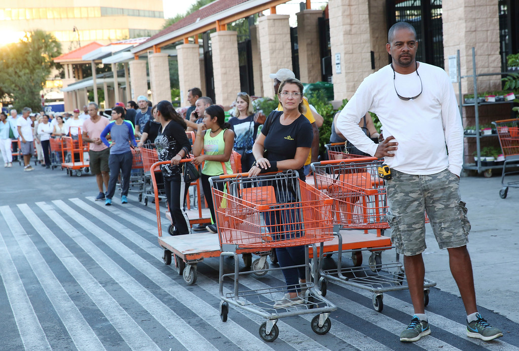 . Eduardo Soriano of Miami, waits in a line since dawn to purchase plywood sheets at a Home Depot store in North Miami, Fla., Wednesday, Sept. 6, 2017. Florida residents are preparing for the possible landfall of Hurricane Irma, the most powerful Atlantic Ocean hurricane in recorded history. (AP Photo/Marta Lavandier)