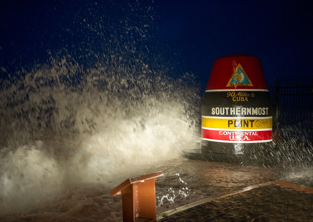 . Waves crash against the Southernmost Point in Key West, Fla., Saturday, Sept. 9, 2017. Hurricane Irma\'s leading edge bent palm trees and spit rain as the storm swirled toward Florida on Saturday. (Rob O\'Neal/The Key West Citizen via AP)