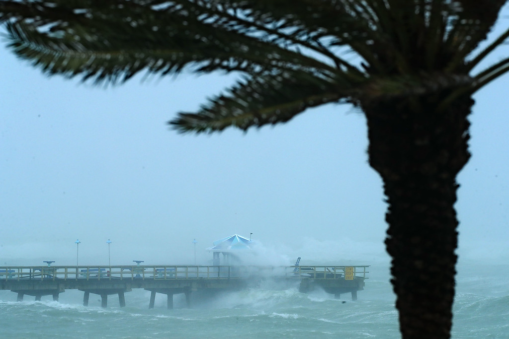 . FORT LAUDERDALE, FL - SEPTEMBER 10:  Large waves produced by Hurricane Irma crash into the end of Anglins Fishing Pier September 10, 2017 in Fort Lauderdale, Florida. The category 4 hurricane made landfall in the United States in the Florida Keys at 9:10 a.m. after raking across the north coast of Cuba.  (Photo by Chip Somodevilla/Getty Images)