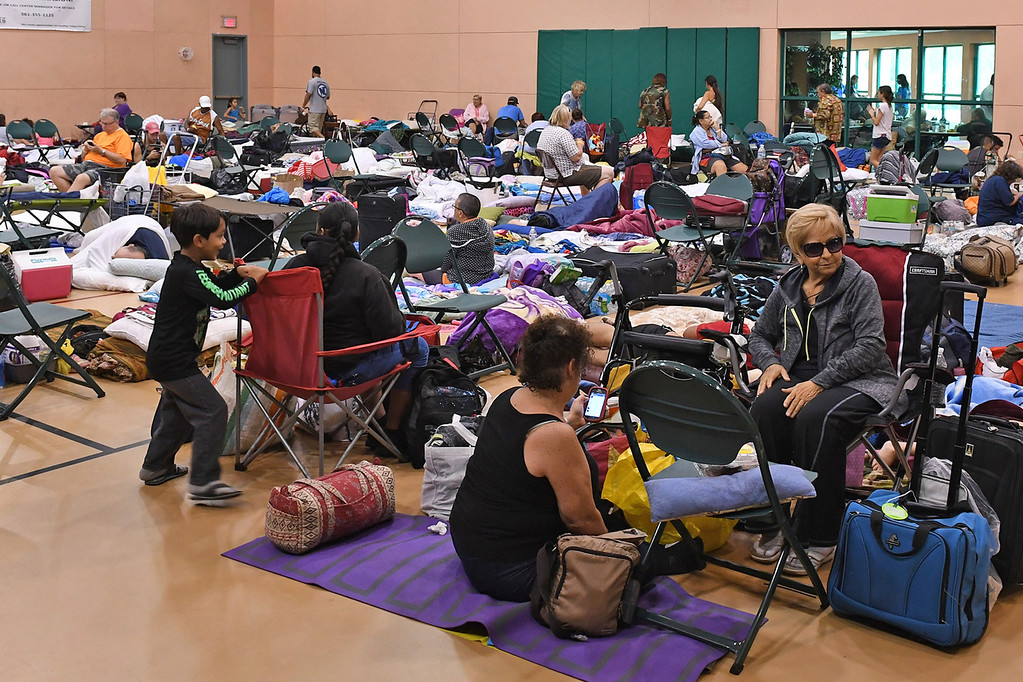. People seek shelter from Hurricane Irma at the West Boynton Park and Recreation Center in Boynton, Beach, Fla., on Saturday, Sept. 9, 2017.    (Jim Rassol /South Florida Sun-Sentinel via AP)