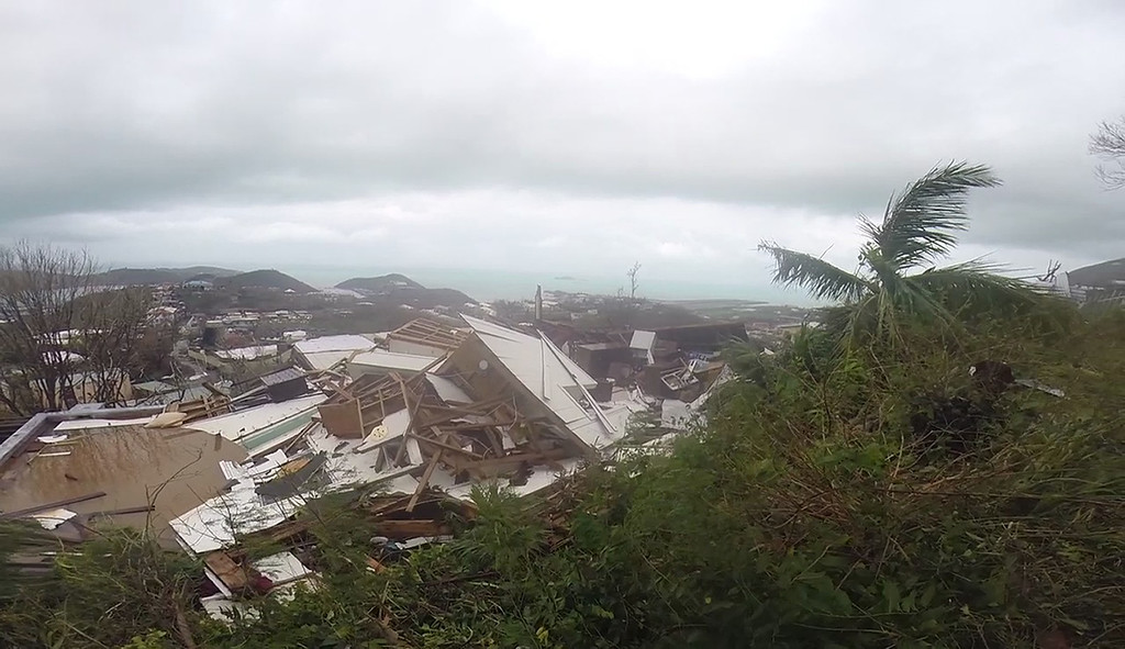 . This image made from video shows several damaged houses by Hurricane Irma in St. Thomas, U.S. Virgin Islands, Thursday, Sept. 7, 2017. Hurricane Irma weakened slightly Thursday with sustained winds of 175 mph, according to the National Hurricane Center. The storm boasted 185 mph winds for a more than 24-hour period, making it the strongest storm ever recorded in the Atlantic Ocean. The storm was expected to arrive in Cuba by Friday. It could hit the Florida mainland by late Saturday, according to hurricane center models. (AP Photo/Ian Brown)