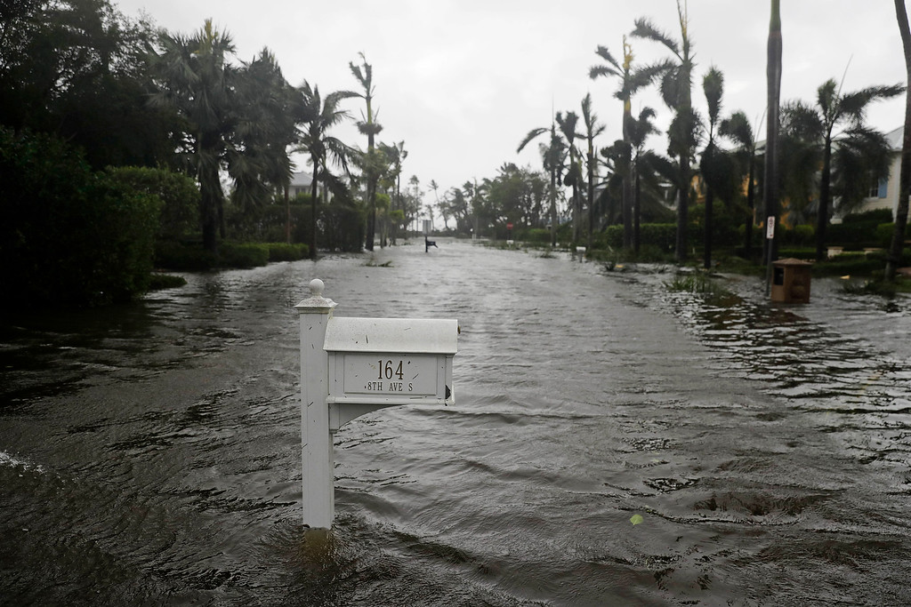 . A street is flooded as Hurricane Irma passes through Naples, Fla., Sunday, Sept. 10, 2017. (AP Photo/David Goldman)