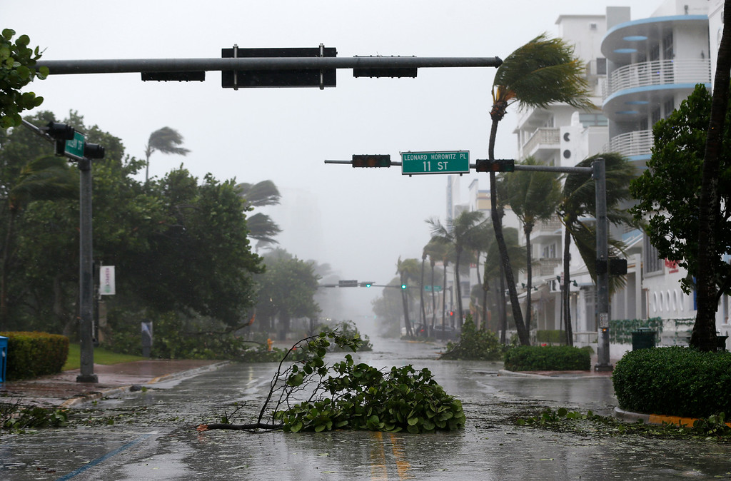 . Debris is strewn across a normally busy street in South Beach as Hurricane Irma passes by, Sunday, Sept. 10, 2017, in Miami Beach, Fla. (AP Photo/Wilfredo Lee)