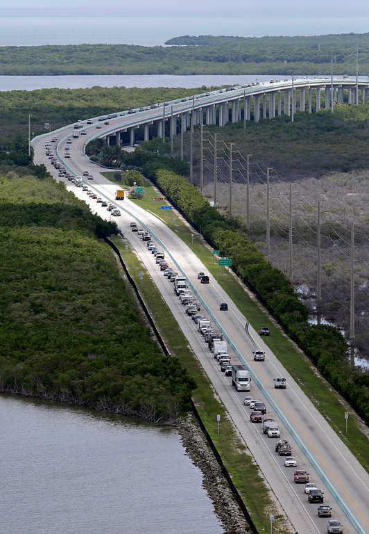 . Motorists head north on US 1, Wednesday, Sept. 6, 2017, in Key Largo, Fla., in anticipation of Hurricane Irma.  Keys officials announced a mandatory evacuation Wednesday for visitors, with residents being told to leave the next day. (AP Photo/Alan Diaz)