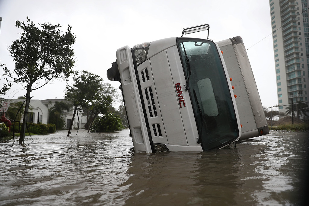 . MIAMI, FL - SEPTEMBER 10:  A truck is seen on its side after being blown over as Hurricane Irma passed through on September 10, 2017 in Miami, Florida. Hurricane Irma, which first made landfall in the Florida Keys as a Category 4 storm on Sunday, has weakened to a Category 2 as it moves up the coast.  (Photo by Joe Raedle/Getty Images)