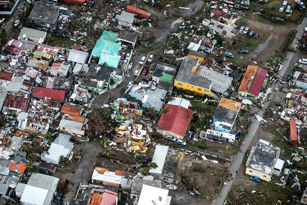 . This Sept. 6, 2017 photo provided by the Dutch Defense Ministry shows storm damage in the aftermath of Hurricane Irma, in St. Maarten. Irma cut a path of devastation across the northern Caribbean, leaving thousands homeless after destroying buildings and uprooting trees. Significant damage was reported on the island that is split between French and Dutch control. (Gerben Van Es/Dutch Defense Ministry via AP)