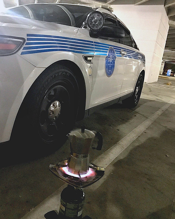 . In this Saturday, Sept. 9, 2017 photo released by the Miami Police Department, a coffee pot sits on heat, in Miami. Some Miami Police officers remembered to pack an essential item in their hurricane survival pack: Cuban coffee, also known as cafecito. The police department tweeted a picture late Saturday showing a stovetop coffee maker atop a camp stove. (Miami Police Department via AP)