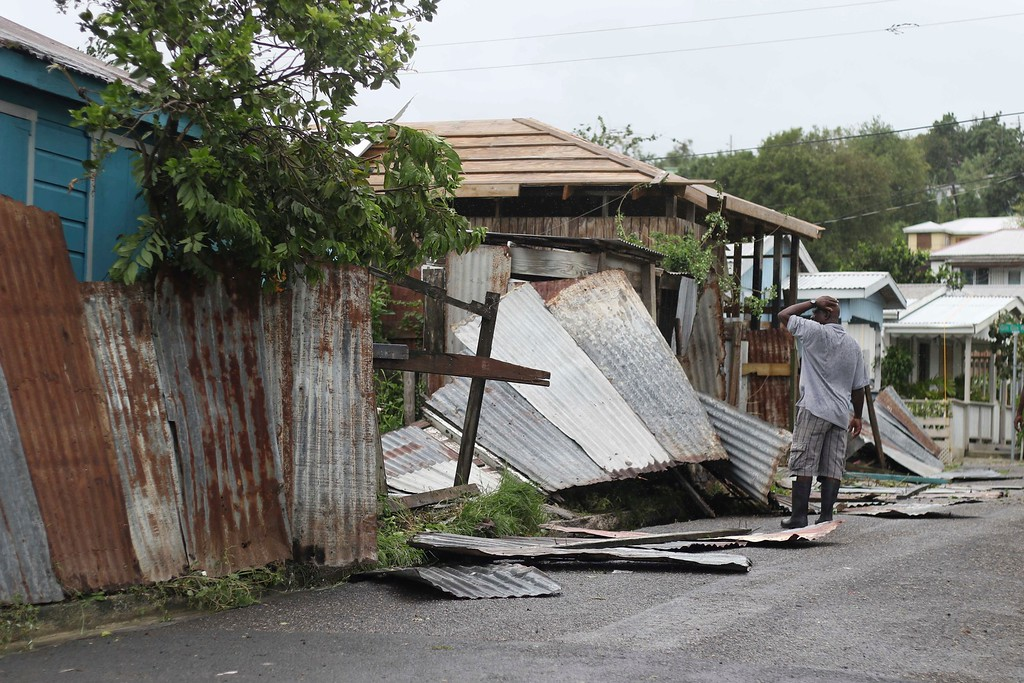 . A man surveys the wreckage on his property after the passing of Hurricane Irma, in St. John\'s, Antigua and Barbuda, Wednesday, Sept. 6, 2017. Heavy rain and 185-mph winds lashed the Virgin Islands and Puerto Rico\'s northeast coast as Irma, the strongest Atlantic Ocean hurricane ever measured, roared through Caribbean islands on its way to a possible hit on South Florida. (AP Photo/Johnny Jno-Baptiste)